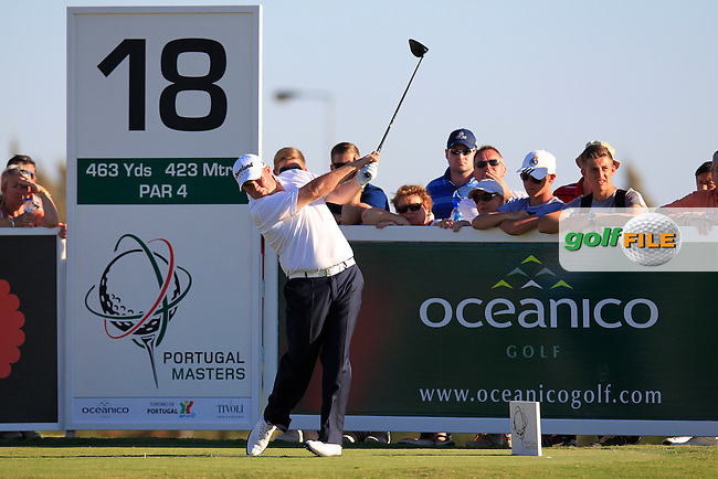 Shane Lowry (IRL) tees off the 18th tee during Friday's Round 2 of the 2013 Portugal Masters held at the Oceanico Victoria Golf Club. 11th October 2013.<br /> Picture: Eoin Clarke www.golffile.ie