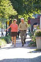 Couple strolls down Main Street, Moorestown, New Jersey