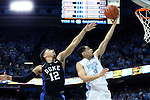 17 February 2016: North Carolina's Marcus Paige (5) gets behind Duke's Derryck Thornton (12). The University of North Carolina Tar Heels hosted the Duke University Blue Devils at the Dean E. Smith Center in Chapel Hill, North Carolina in a 2015-16 NCAA Division I Men's Basketball game. Duke won the game 74-73.