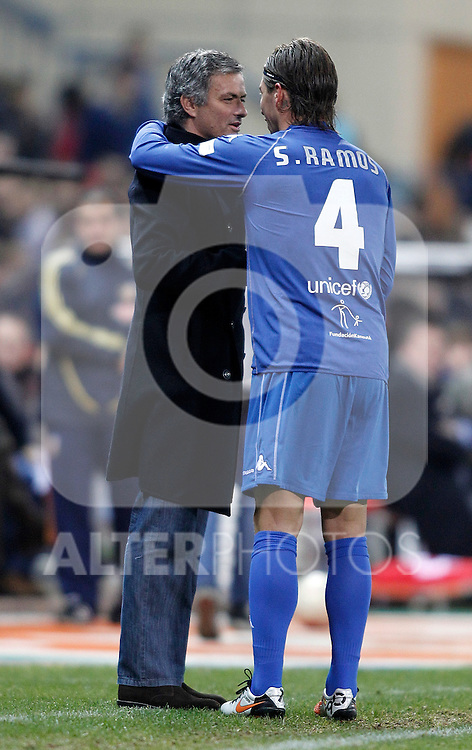 Real Madrid's coach Jose Mourinho and Sergio Ramos embrace and joke during UNICEF match. December, 29 2010. (ALTERPHOTOS/Alvaro Hernandez)