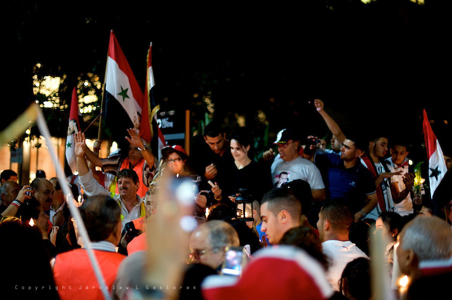 Sydney, 12.01.2012. Syrian community once again shows strong support for the president Bashar al-Assad in front of the US Consulate at Martin Place during candle light vigil for the soldiers who have died in the fight against armed protesters.