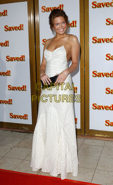 "MANDY MOORE.At the United Artists' World Premiere of ""Saved!"" at the Mann National Theatre, .Westwood, California,.May 13,2004.full length full-length pinstripe white spagetti strap dress tan black clutch bag.*UK sales only*.www.capitalpictures.com.sales@capitalpictures.com.©Debbie Van Story/Capital Pictures"