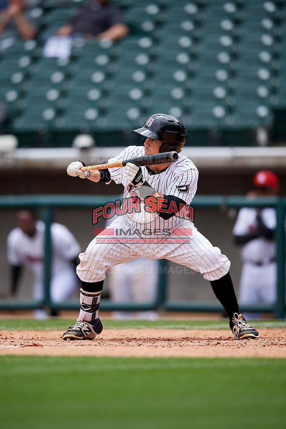 Birmingham Barons catcher Brett Austin (18) squares around to bunt during a game against the Jacksonville Jumbo Shrimp on April 24, 2017 at Regions Field in Birmingham, Alabama.  Jacksonville defeated Birmingham 4-1.  (Mike Janes/Four Seam Images)