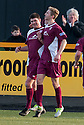 Arbroath's Derek Holmes (left) celebrates after he scores their first goal .
