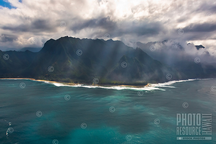 Na Pali Coast (or Napali Coast), northern Kaua'i, seen during a helicopter tour on a sunny day.