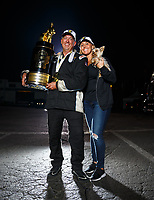 Nov 12, 2017; Pomona, CA, USA; NHRA pro stock driver Bo Butner poses for a portrait with girlfriend Randi Lynn Shipp and the trophy after clinching the 2017 world championship during the Auto Club Finals at Auto Club Raceway at Pomona. Mandatory Credit: Mark J. Rebilas-USA TODAY Sports