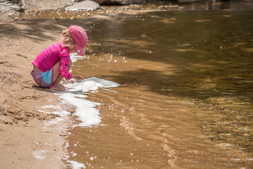 A child plays on a Lake Superior beach.