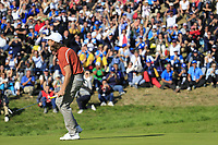 Tommy Fleetwood (Team Europe) sinks his putt on the 9th green during Saturday's Foursomes Matches at the 2018 Ryder Cup 2018, Le Golf National, Ile-de-France, France. 29/09/2018.<br /> Picture Eoin Clarke / Golffile.ie<br /> <br /> All photo usage must carry mandatory copyright credit (&copy; Golffile | Eoin Clarke)