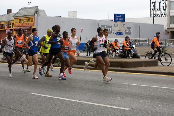 Meb Keflezighi (USA, l) stays near the front of the pack of Men's Elite runners as they approach Mile 7 in the ING New York City Marathon.