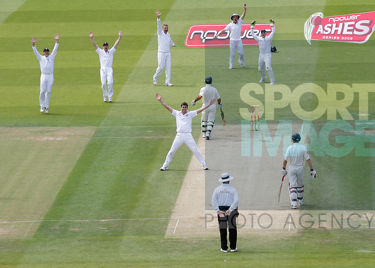 England's James Anderson celebrates taking the wicket of Ricky Ponting for 4