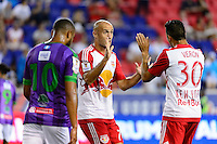 Harrison, NJ - Wednesday Aug. 03, 2016: Aurelien Collin, Gonzalo Veron during a CONCACAF Champions League match between the New York Red Bulls and Antigua at Red Bull Arena.