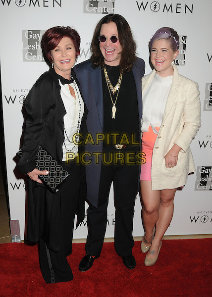 "Sharon Osbourne, Ozzy Osbourne, Kelly Osbourne.LA Gay & Lesbian Center's ""An Evening With Women"" 2013 held at the Beverly Hilton Hotel, Beverly Hills, California, USA, 18th May 2013..full length black white shirt clutch bag gold necklaces husband wife couple married daughter parents family jacket suit beige cream coat peach pink skirt top .CAP/ADM/BP.©Byron Purvis/AdMedia/Capital Pictures"