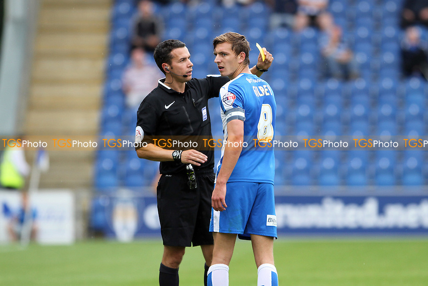 Alex Gilbey of Colchester United gets a caution from match referee Mr D Whitestone during Colchester United vs Scunthorpe United, Sky Bet League 1 Football at the Weston Homes Community Stadium, Colchester, England on 29/08/2015