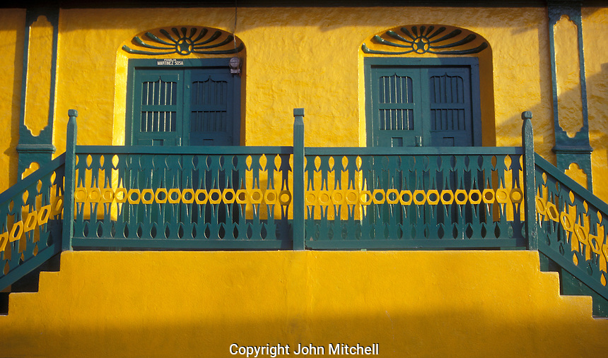 Colourful restored house on the island of Flores, El Peten, Guatemala.