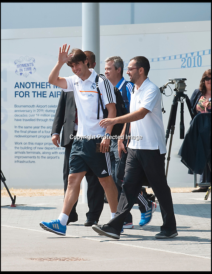 BNPS.co.uk (01202 558833)<br /> Pic: PhilYeomans/BNPS<br /> <br /> Kaka emerges from the terminal building.<br /> <br /> Footballing aristocrats Real Madrid flew into the unlikely enviroment of Bournemouth today for a much anticipated friendly against the seaside town's football team.<br /> <br /> Despite fears that their second team would turn up excited fans at the airport couldn't beleive their eyes when Ancelotti led out Ronaldo, Zidane, Kaka, Modric and many more stars from the terminal building.