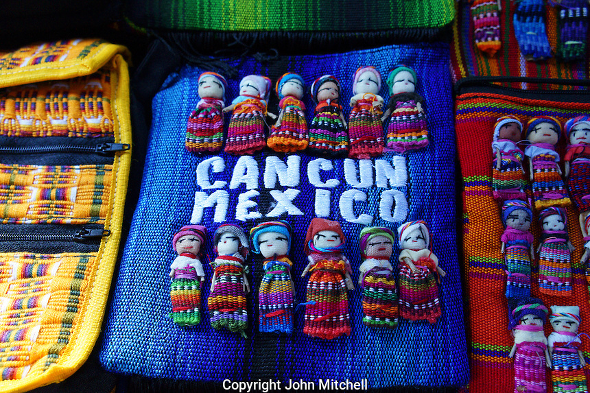 Mayan dolls and bags in Mercado 28 souvenirs and handicrafts market in  Cancun, Mexico      .