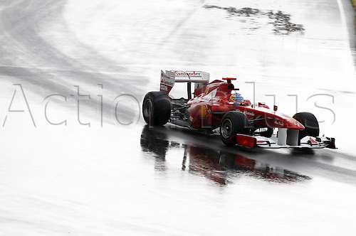 12 06 2011  FIA Formula One World Championship 2011 Grand Prix of Canada 05 Fernando Alonso ESP Scuderia Ferrari Marlboro takes a corner in heavy rainfaill