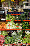 Vegetables and fruits on display in a market.