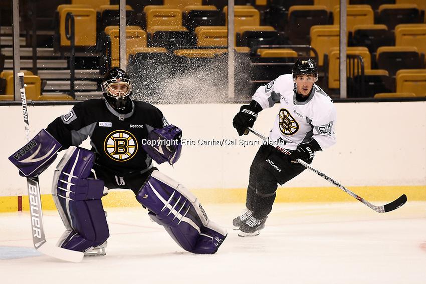 September 18, 2015 - Boston, Massachusetts, U.S. - Boston Bruins goalie Matthew Ginn (90) and left wing Brad Marchand (63) skate in a drill during the Boston Bruins training camp held at TD Garden in Boston Massachusetts. Eric Canha/CSM