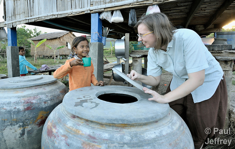 Katherine Parker, right, a United Methodist missionary, talks with a girl getting clean water to drink in the Cambodian village of Pheakdei. Parker works with the Community Health and Agricultural Development program of the Methodist Mission in Cambodia.