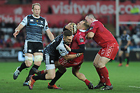 Ioan Nicholas of Scarlets is tackled by George North of Ospreys during the Guinness Champions Cup play-off match between the Ospreys and Scarlets at the Liberty Stadium in Swansea, Wales, UK.  Saturday 18 May 2019