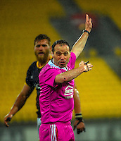 Referee Cameron Stone awards a penalty during the ITM Cup rugby union match between Wellington Lions and Northland at Westpac Stadium, Wellington, New Zealand on Saturday, 29 August 2015. Photo: Dave Lintott / lintottphoto.co.nz