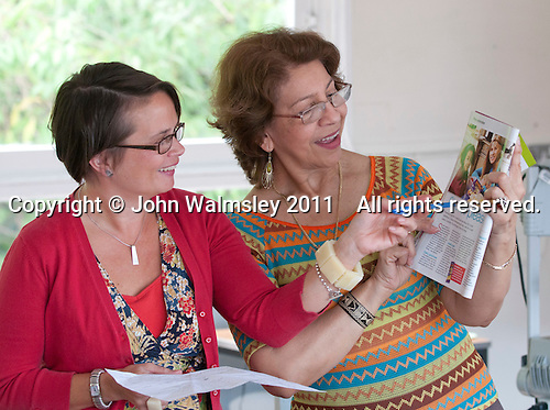 Student & tutor discussing a magazine, Spanish class, Adult Learning Centre, Guildford, Surrey.