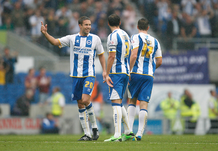 Brighton and Hove albion's Matthew Upson (L) celebrates with team mates after Andrew Crofts (Not Pictured) scored their first goal<br /> <br /> (Photo by Jack Phillips/CameraSport)<br /> <br /> Football - The Football League Sky Bet Championship - Brighton and Hove Albion v Burnley - Saturday 24th August 2013 - American Express Community Stadium - Brighton<br /> <br /> &copy; CameraSport - 43 Linden Ave. Countesthorpe. Leicester. England. LE8 5PG - Tel: +44 (0) 116 277 4147 - admin@camerasport.com - www.camerasport.com