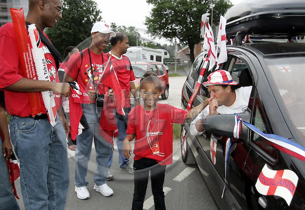 NÜRNBERG - GERMANY -- 15  JUNE 2006 -- FIFA Worldcup 2006. -- English supporter in his car with with Trinidad & Tobago fans in Nuremberg after the match which ended 2-0 in favour of England.-- PHOTO:  JUHA ROININEN / EUP-IMAGES
