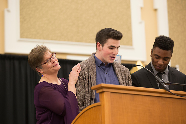 Emcees Zach Pine, center, and Josh Brown, right, introduce Dr. Julie Suhr, left, one of the contestants at the 8th Annual Ava Nichols Faculty Pageant on Feb. 27, 2017.