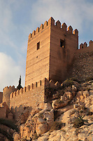 Tower and ramparts of the Alcazaba, a 10th century fortified enclosure and royal residence in Almeria, Andalusia, Southern Spain. It was begun in 955 by Rahman III and completed by Hayran, Taifa king of Almeria, in the 11th century. It was later added to by the Catholic monarchs. Picture by Manuel Cohen