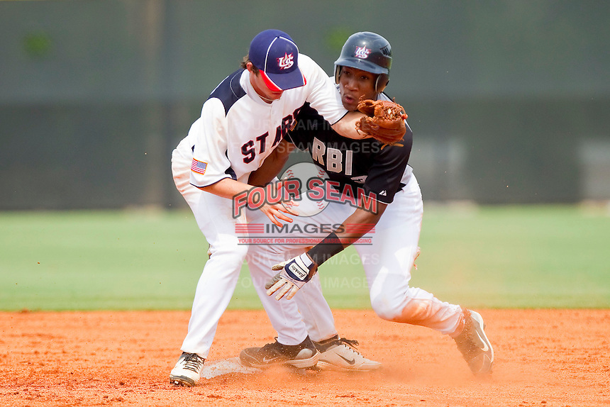 Bralin Jackson #3 of RBI slides into second base ahead of the tag by Landon Lassiter #6 of STARS at the 2011 Tournament of Stars at the USA Baseball National Training Center on June 26, 2011 in Cary, North Carolina. (Brian Westerholt/Four Seam Images)