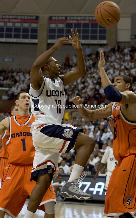 STORRS, CT--05 FEBRUARY 2007--020507JS08- UConn's A.J. Price looses the handle on the ball while driving to the basket on Syracuse's Terrence Roberts during their Big East Game Monday at Gampel Pavilion in Storrs. <br /> Jim Shannon / Republican-American