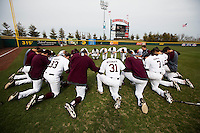 Members of the Missouri State Bears pray prior to a game against the Northwestern Wildcats at Hammons Field on March 8, 2013 in Springfield, Missouri. (David Welker/Four Seam Images)