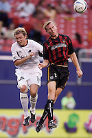 The Burn's Bobby Rhine and the MetroStars' Chris Leitch go up for a header. The Dallas Burn defeated the MetroStars 1-0 at Giant's Stadium, East Rutherford, NJ, on August 15, 2004.