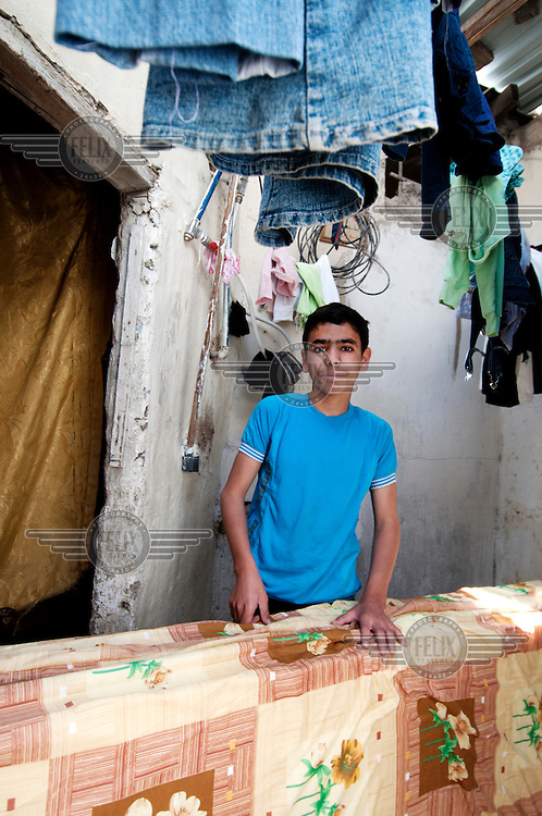 15 year old Hassan holds on to a new mattress in the house where he is living in Amman after fleeing the civil war in neighbouring Syria. 'I miss school. I liked learning Arabic and sports. My favourite sport is football and I like Real Madrid but my brother likes Manchester United. During a class in Syria a bullet came through the window and went into the blackboard and the teacher fainted. I remember my house but it is now just a memory. Syria as it was is a memory.' /Felix Features