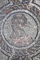 Autumn, medallion from the Roman mosaic of the Four Seasons, in the dining room of the House of Dionysos, 3rd century AD, Volubilis, Northern Morocco. Volubilis was founded in the 3rd century BC by the Phoenicians and was a Roman settlement from the 1st century AD. Volubilis was a thriving Roman olive growing town until 280 AD and was settled until the 11th century. The buildings were largely destroyed by an earthquake in the 18th century and have since been excavated and partly restored. Volubilis was listed as a UNESCO World Heritage Site in 1997. Picture by Manuel Cohen