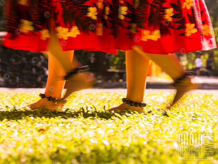 Young hula dancers walk by at a recital in Waimea Valley on O'ahu.