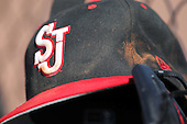 St. John's Red Storm hat on the dugout step during a game vs the Ohio State Buckeyes at the Big East-Big Ten Challenge at Walter Fuller Complex in St. Petersburg, Florida;  February 20, 2011.  Ohio State defeated St. John's 8-7 in 11 innings.  Photo By Mike Janes/Four Seam Images