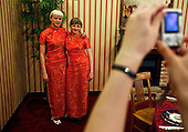 Waitresses working in a Chinese restaurant in Khabarovsk city, on the bank of the Amur River, have a photo taken. The Amur runs along the border separating Russia and China.