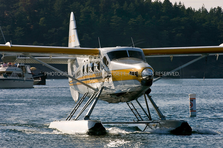 8/28/2006--Roche Harbor, San Juan Islands, WA, USA..A Kenmore Air sea plane, piloted by Fred Brink, leaves Roche Harbor...Photograph By Stuart Isett.All photographs ©2006 Stuart Isett.All rights reserved.