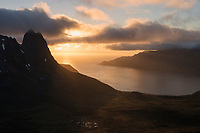 June midnight sun over Øyfjord, Fjordgård, Senja, Norway