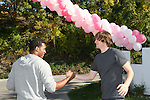 Guiding Light's actors Lawrence Saint-Victor & Zack Conroy great each other on October 1, 2009 in Pittsburgh, PA area as the actors visit Moon Township Honda after going to the various GO PINK Panera Bread locations. Proceeds from pink ribbon bagel sales will benefit the Young Women's Breast Cancer Awareness Foundation. (Photo by Sue Coflin/Max Photos)