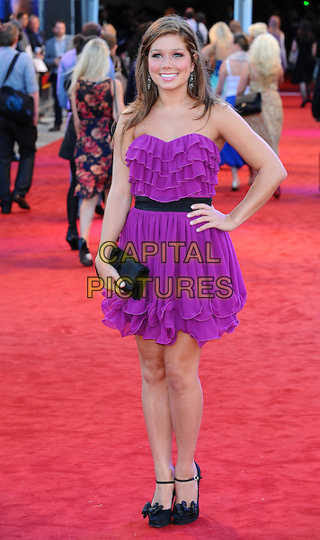 "Nikki Sanderson.The UK Premiere of ""Cowboys And Aliens"", O2 Arena, London, England..11th August 2011.full length purple strapless dress black clutch bag layers hand on hip ankle strap shoes . CAP/BEL.©Tom Belcher/Capital Pictures."