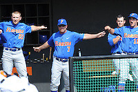 Florida Gators head coach Kevin O'Sullivan #7 helps the umps with a call at the plate during a game against the Tennessee Volunteers at Lindsey Nelson Stadium, Knoxville, Tennessee April 14, 2012. The Volunteers won the game 5-4  (Tony Farlow/Four Seam Images)..