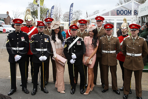08.04.2016. Aintree, Liverpool, England. Crabbies Grand National Festival Day 2. Racegoers pose with the Guards on arrival at the track.