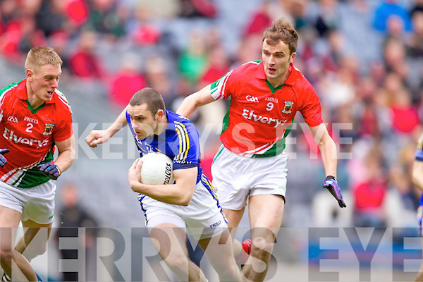 Patrick Curtin Kerry in action against  Kevin Keane and Jason Gibbons  Mayo in the National Football League Semi Final at Croke Park on Sunday.