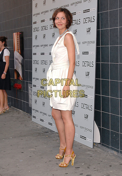 "MAGGIE GYLLENHAAL.Film Premiere of ""Happy Endings"" at the Chelsea Clearview Theater in Manhattan, New York, NY, USA, .July 12th 2005..full length white belted mini dress orange  velvet strappy high shoes .Ref: ADM.www.capitalpictures.com.sales@capitalpictures.com.©Patti Ouderkirk/AdMedia/Capital Pictures."