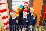 l-r Eimer O'Sullivan, Ciara Samy, Niamh O'Mahony and Arvresha Kastrati. Students at the Presentation Secondary School Santa Hat Day in aid of Ronald McDonald House.