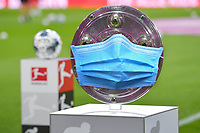 16th August 2019, Munich, Germany. A Photo Montge shows a protective mask over the Bundesliga trophy during the game between Bayern Munich and Hertha BSC Berlin- altered image